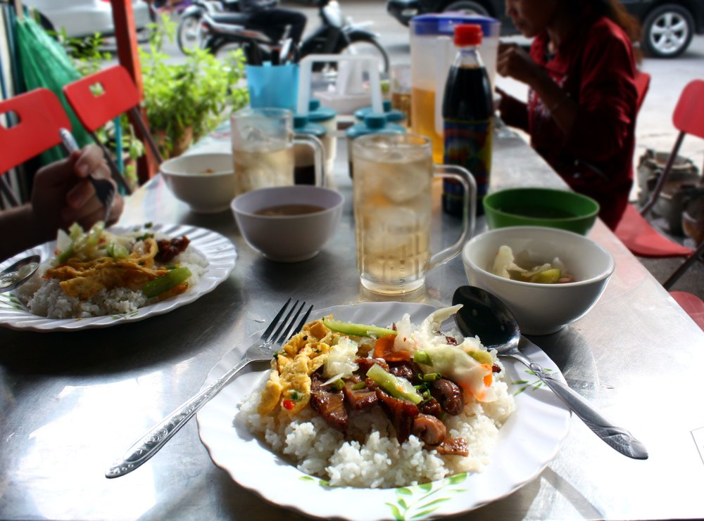 Bai Sach Chrouk : a classic Cambodian breakfast of grilled pork, pickled vegetables, and egg, on top of rice.