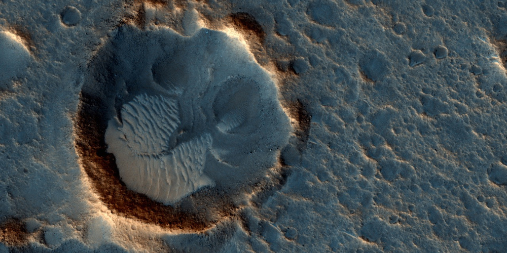 "This May 2015 image from the HiRISE camera on NASA's Mars Reconnaissance Orbiter shows a location on Mars associated with the best-selling novel and Hollywood movie, ""The Martian."" Image credit: NASA/JPL-Caltech/Univ. of Arizona"