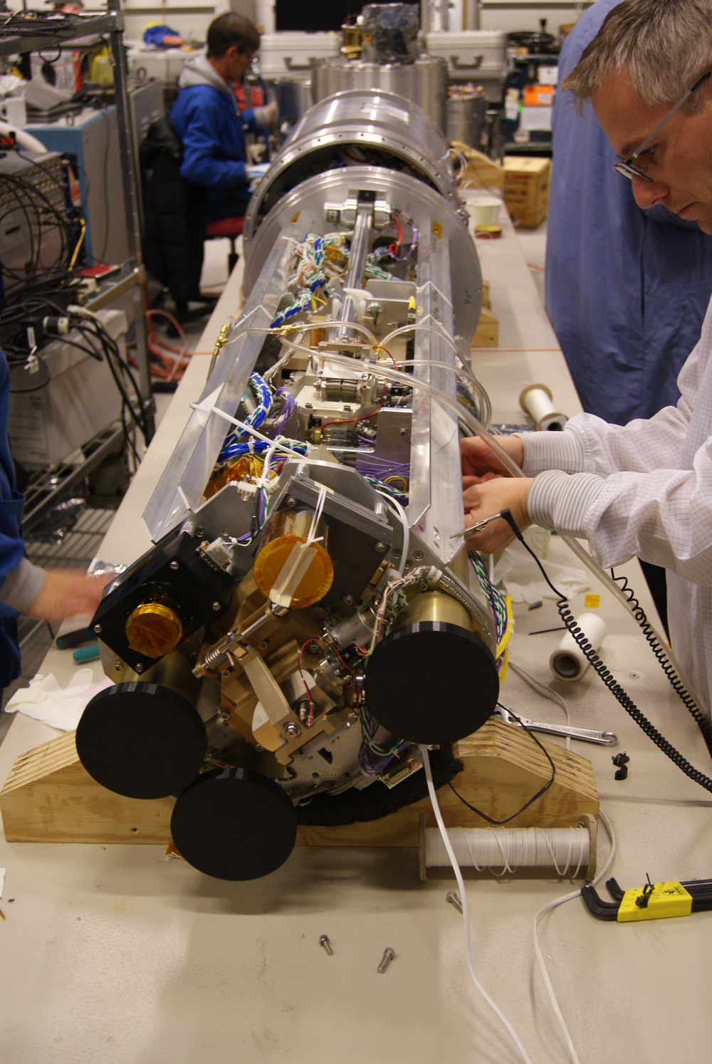 Team members work on the RENU 2 sounding rocket weeks before its launch window opens Nov. 27, 2015. Scientists will have to wait for favorable weather conditions and the presence of a daytime aurora before they can launch. RENU 2, short for Rocket Experiment for Neutral Upwelling, will study the relationship between the flowing electrons that create the cusp aurora and dense columns of neutral atoms in the upper atmosphere. - Image Credit: NASA/University of New Hampshire/Bruce Fritz