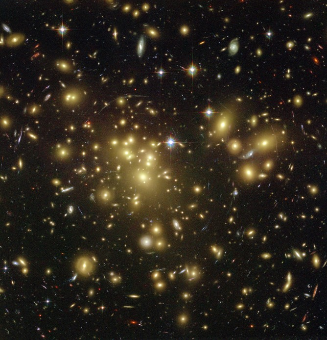 Could supersymmetry one day crack the mystery of all the dark matter lurking in galaxy clusters?   - Image Credit:    NASA/wikimedia