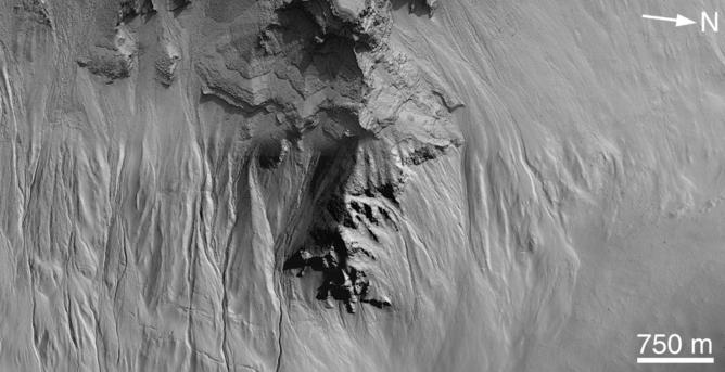 Gullies inside a Martian crater. – Image Credit: NASA