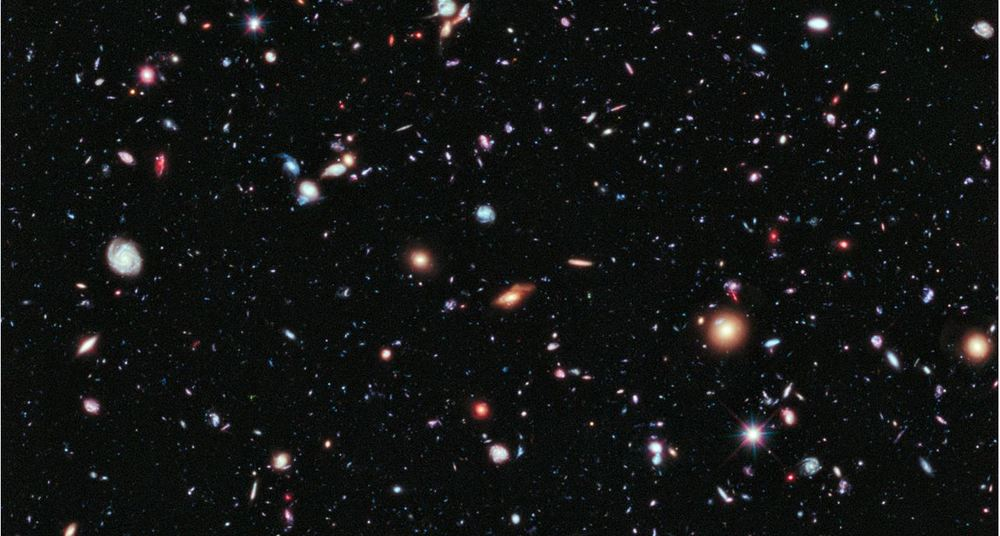 How do we think about something we can't see and don't experience in our everyday lives, but seems to be pushing our universe apart ever faster? – Image Credit:NASA, ESA