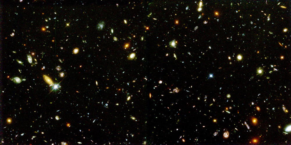 What pushes galaxies like these in the Hubble deep field apart?– Image Credit: NASA and A. Riess (STScI)