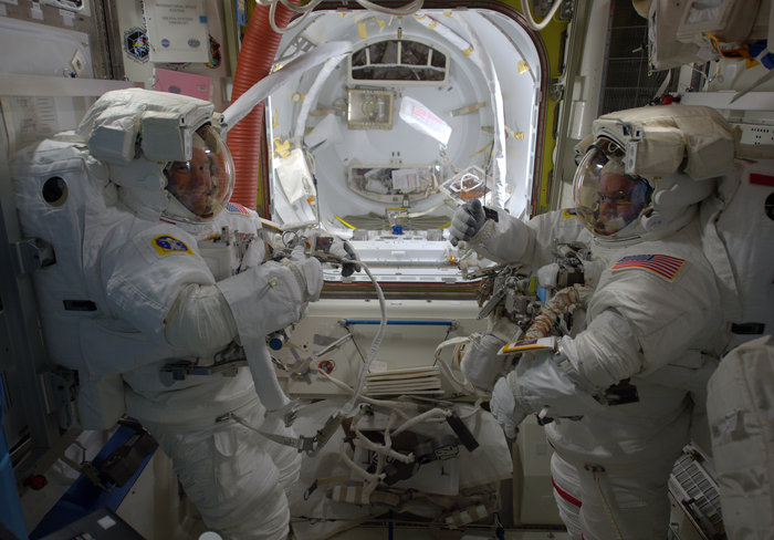 NASA astronauts Scott Kelly and Tim Kopra prepare for a spacewalk, December 2015. - Image Credit: ESA/NASA