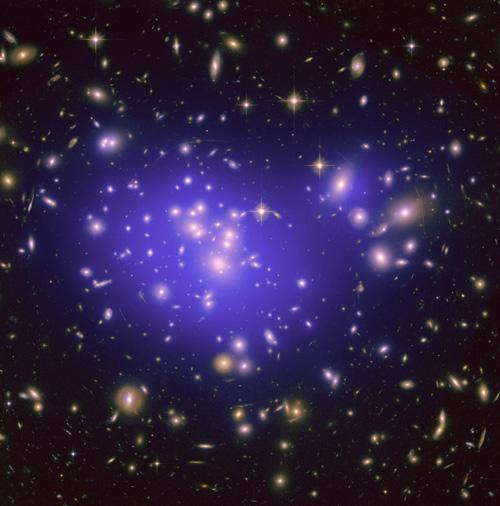 This image from NASA's Hubble Space Telescope shows the inner region of Abell 1689, an immense cluster of galaxies. Scientists say the galaxy clusters we see today have resulted from fluctuations in the density of matter in the early universe. - Image Credit: NASA/ESA/JPL-Caltech/Yale/CNRS