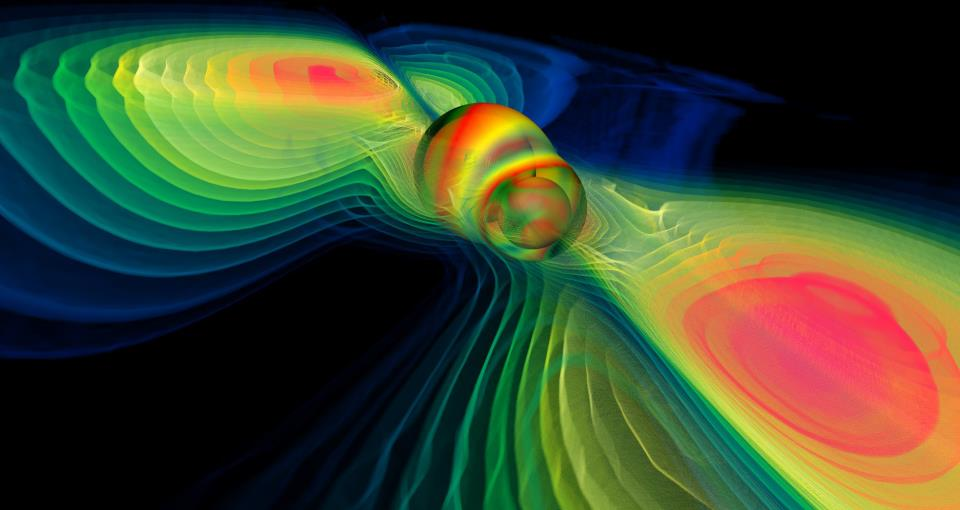 Computer simulation of two merging black holes producing gravitational waves. – Image Credit:  NASA Blueshift/WikimediaCommons