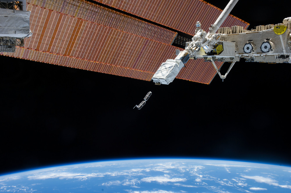 In February 2014, Planet Labs Inc. launched its first flock of Dove nanosatellites into space. Shown are two shoebox-sized Doves being ejected into low-Earth orbit from the International Space Station. The company's goal is for the flock to take a high-resolution snapshot of nearly the entire globe every 24 hours. - Image   Credits: NASA