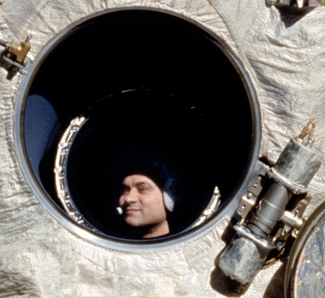 Cosmonaut Polyakov, who holds the record for longest time spent in space with 438 days, looks out Mir's window. - Image Credit: NASA