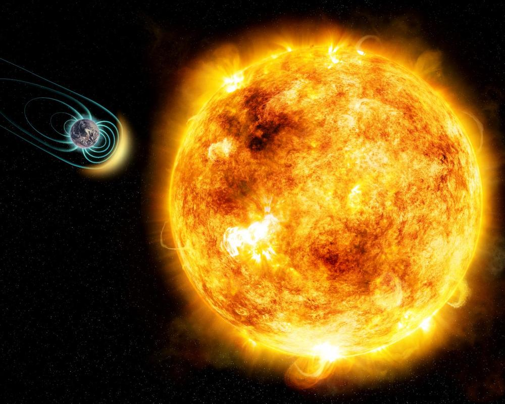 In this artist's illustration, the young Sun-like star Kappa Ceti is blotched with large starspots, a sign of its high level of magnetic activity. New research shows that its stellar wind is 50 times stronger than our Sun's. As a result, any Earth-like planet would need a magnetic field in order to protect its atmosphere and be habitable. The physical sizes of the star and planet and distance between them are not to scale. - Image Credit: M. Weiss/CfA