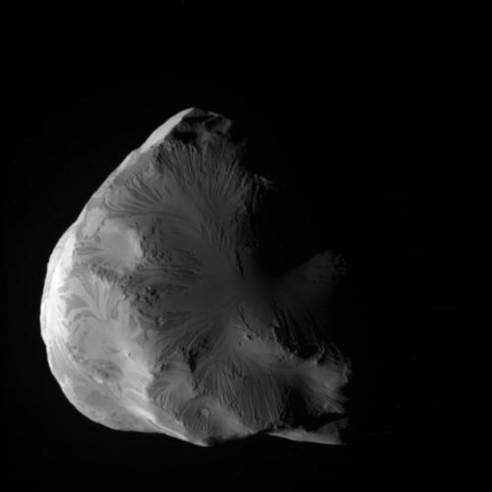 The tiny moon Helene, just 43km across. Is this a chunk of debris from a violent collision 100m years ago? -Image Credit: NASA/JPL-Caltech/Space Science Institute