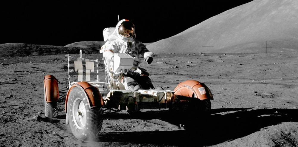 Gene Cernan driving a lunar rover in December 1972. - Image Credit: NASA