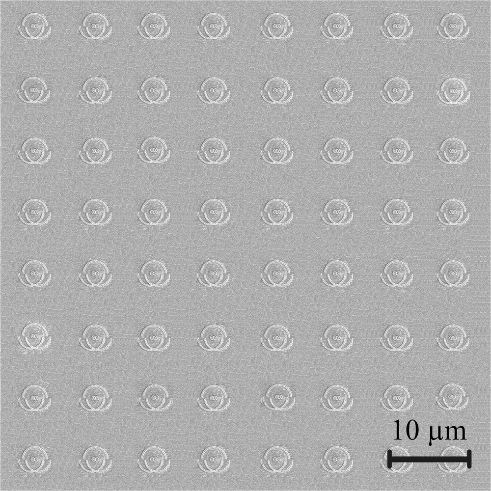 The nanophotonic chip magnified 2,000 times. Each indentation on the image is a single unit of the chip, like a single pixel in a display panel, made up of semi-circle nano-grooves and nano-apertures engraved in a metallic film. RMIT University, Author provided