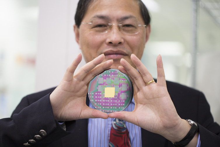 Professor Min Gu with the nanophotonic chip that can harness the angular momentum of light. RMIT University, Author provided