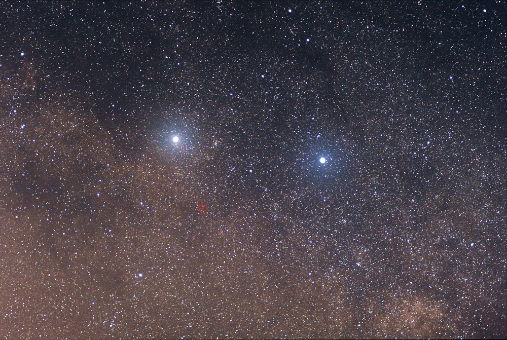 Alpha Centauri (the left-hand bright star), and Proxima Centauri (circled) are the closest stars to the sun. Beta Centauri (right-hand bright star) is almost a hundred times farther away. - Image Credit: Skatebiker/ Wikipedia, CC BY-SA