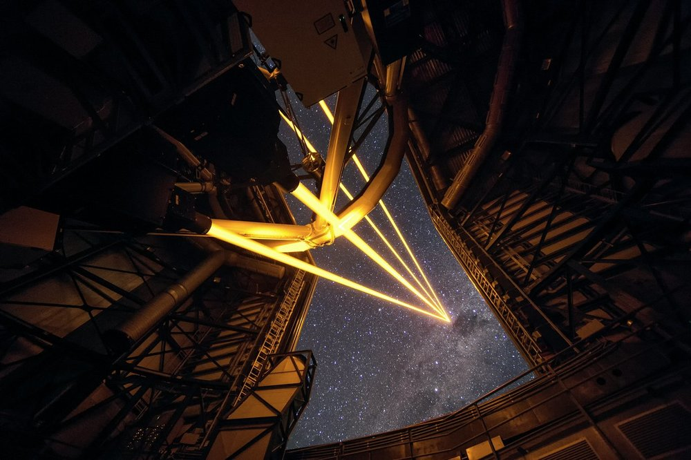 This spectacular image shows the four beams emerging from the new laser system on Unit Telescope 4 of the VLT. – Image Credit: ESO/F. Kamphues
