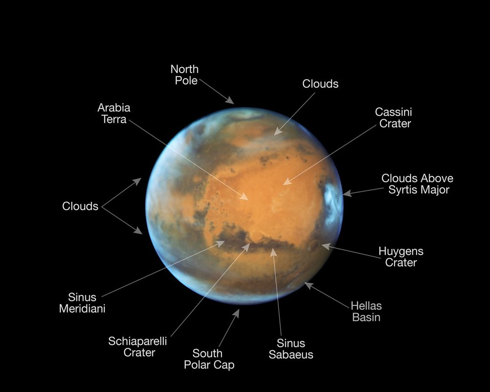 This image shows our neighbouring planet Mars, as it was observed shortly before opposition in 2016 by the NASA/ESA Hubble Space Telescope. Some prominent features on the surface of the planet have been annotated. - Image Credit: NASA, ESA, the Hubble Heritage Team (STScI/AURA), J. Bell (ASU), and M. Wolff (Space Science Institute)