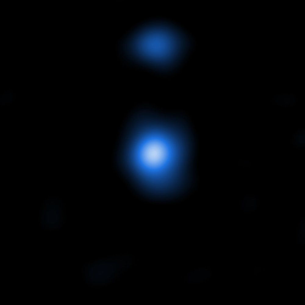 This image shows one of two detected supermassive black hole seeds, OBJ29323, as it is seen by the NASA Chandra Space Telescope. The properties of the X-ray data match those predicted by models produced by the Italian research team. – Image Credit: NASA/CXC/Scuola Normale Superiore/Pacucci