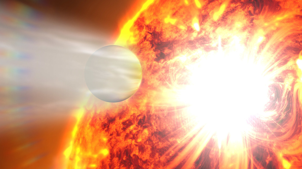 Artists impression of HD 189733 b, a Hot Jupiter so close to its host that its atmosphere is being boiled off into space. - Image Credit: NASA's Goddard Space Flight Center