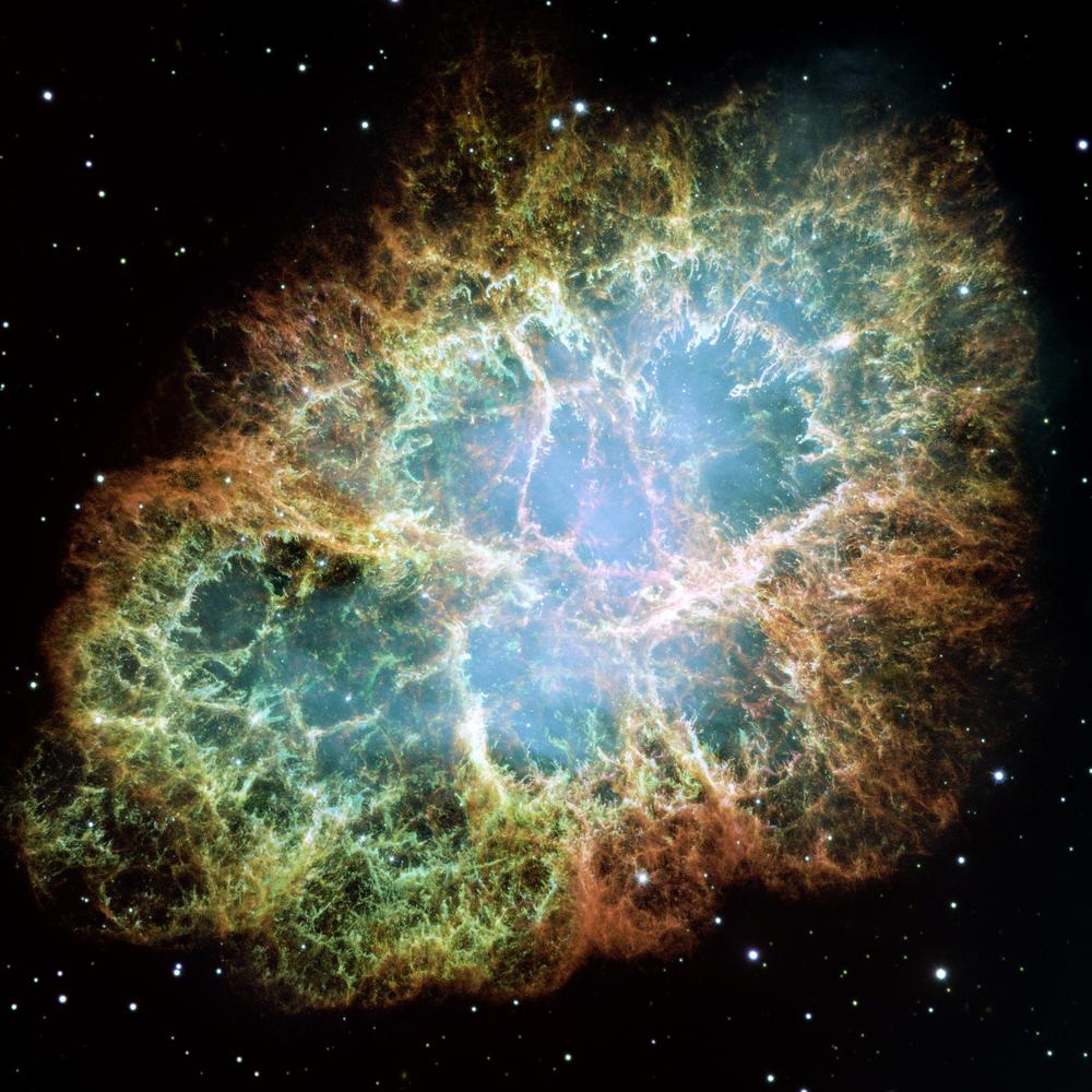 The best-known wind nebula is the Crab Nebula, located about 6,500 light-years away in the constellation Taurus. At the center is a rapidly spinning neutron star that accelerates charged particles like electrons to nearly the speed of light. As they whirl around magnetic field lines, the particles emit a bluish glow. This image is a composite of Hubble observations taken in late 1999 and early 2000. The Crab Nebula spans about 11 light-years. – Image Credits: NASA, ESA, J. Hester and A. Loll (Arizona State University)