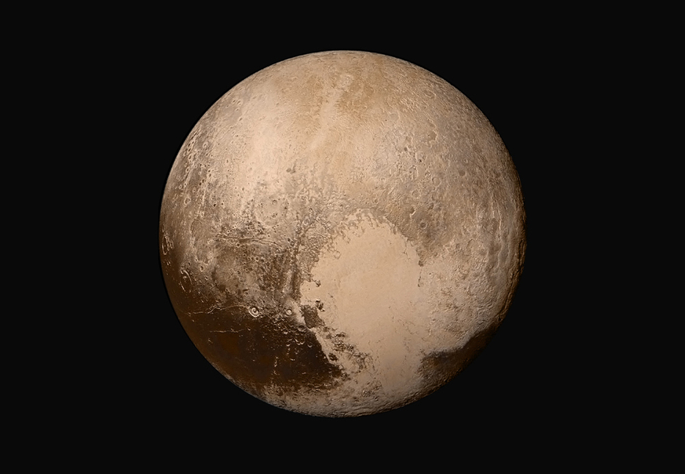 Four images from New Horizons' Long Range Reconnaissance Imager (LORRI) were combined with color data from the Ralph instrument to create this global view of Pluto. The images, taken when the spacecraft was 280,000 miles (450,000 kilometers) away from Pluto, show features as small as 1.4 miles (2.2 kilometers). – Image Credits: NASA/JHUAPL/SwRI