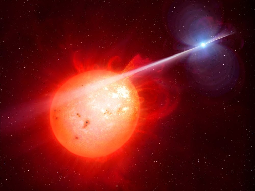 This artist's impression shows the strange object AR Scorpii. In this unique double star a rapidly spinning white dwarf star (right) powers electrons up to almost the speed of light. These high energy particles release blasts of radiation that lash the companion red dwarf star (left) and cause the entire system to pulse dramatically every 1.97 minutes with radiation ranging from the ultraviolet to radio. – Image Credit :  M. Garlick/University of Warwick/ESO