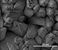 Microstructures on a material sample viewed under a Scanning Electron Microscope. Chris Matthes (UCLA), CC BY-ND