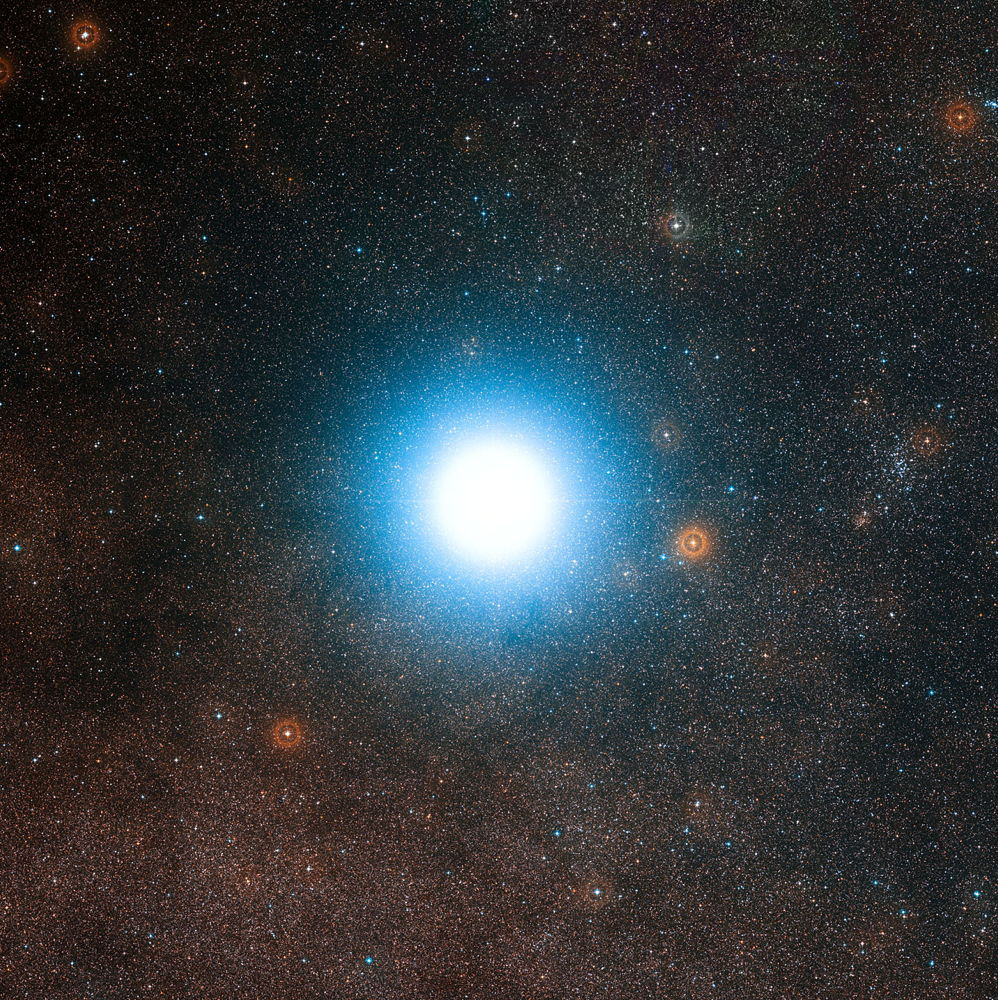Wide-field view of the sky around the bright star Alpha Centauri - Image Credit: ESO/Digitized Sky Survey 2