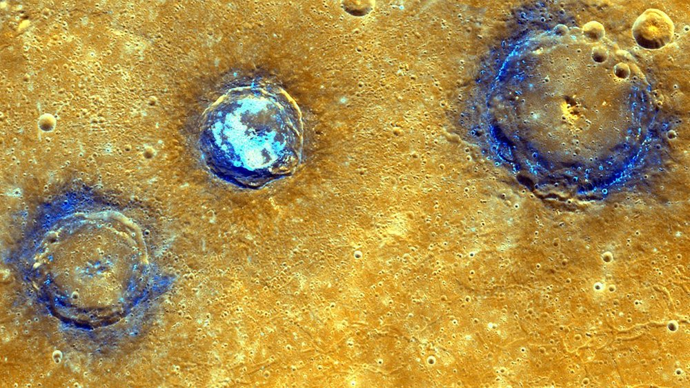 Enhanced-color image of Munch, Sander and Poe craters amid volcanic plains (orange) near Caloris Basin. – Image Credit: NASA/Johns Hopkins University Applied Physics Laboratory/Carnegie Institution of Washington