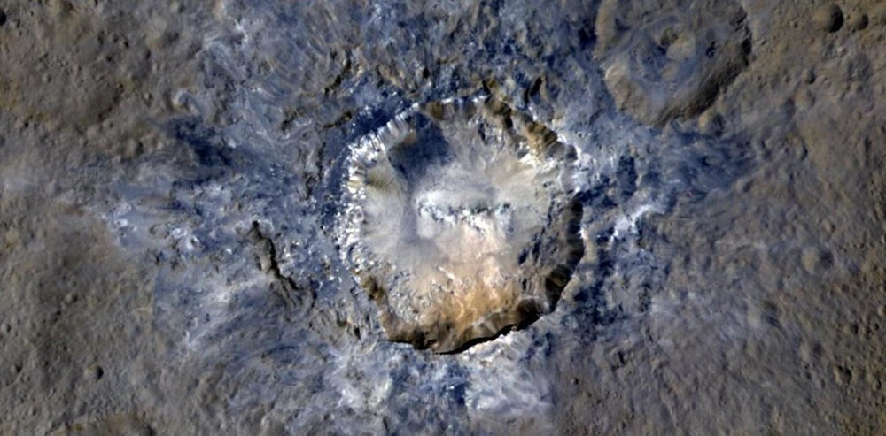 Ceres' Haulani Crater shows evidence of landslides from its crater rim. – Image Credit: NASA/JPL-Caltech/UCLA/MPS/DLR/IDA