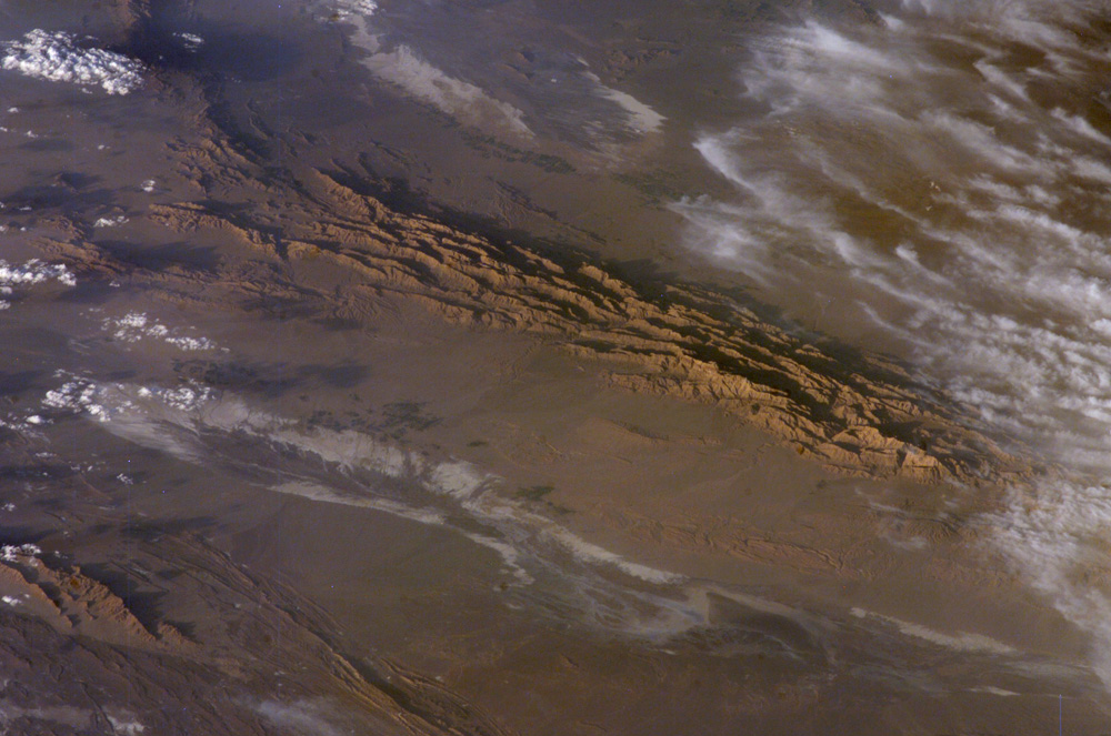 The Lut Desert of Iran, as observed by NASA's Earth Observatory. It was here that the hottest temperature ever was recorded between 2003-9. - Image Credit: NASA
