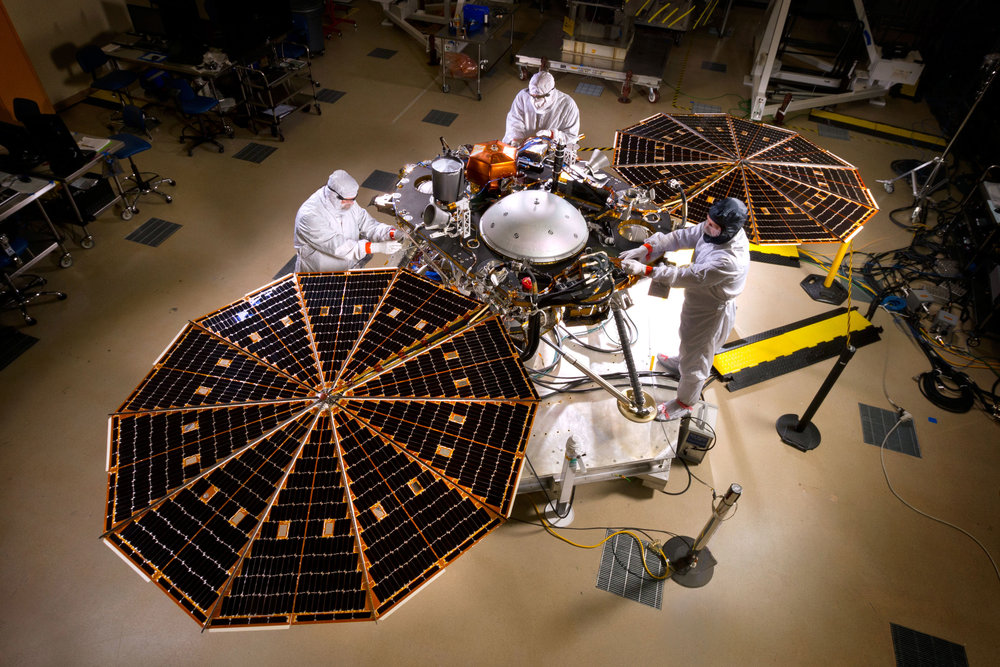 NASA's InSight Mars lander spacecraft in a Lockheed Martin clean room near Denver. As part of a series of deployment tests, the spacecraft was commanded to deploy its solar arrays in the clean room to test and verify the exact process that it will use on the surface of Mars. – Image Credit: NASA/JPL-Caltech/Lockheed Martin