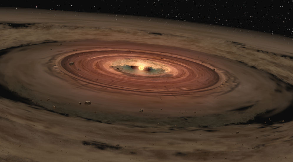 Planets coalescing out of the remaining molecular cloud the star formed out of. Within this accretion disk lay the fundamental elements necessary for planet formation and potential life. Credit: NASA/JPL-Caltech/T. Pyle (SSC) – February, 2005