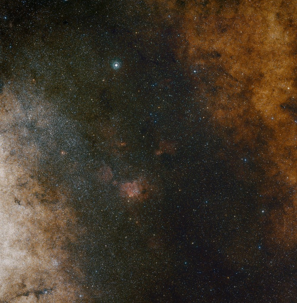 This visible light wide-field view shows the rich star clouds in the constellation of Sagittarius (the Archer) in the direction of the centre of our Milky Way galaxy. The entire image is filled with vast numbers of stars — but far more remain hidden behind clouds of dust and are only revealed in infrared images. This view was created from photographs in red and blue light and forming part of the Digitized Sky Survey 2. The field of view is approximately 3.5 degrees x 3.6 degrees. – Image Credit: ESO and Digitized Sky Survey 2. Acknowledgment: Davide De Martin and S. Guisard