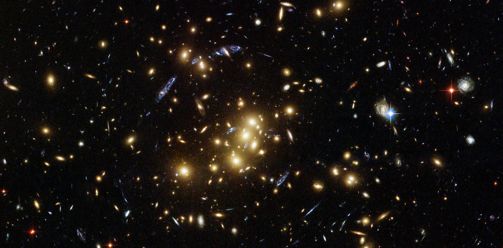 Rich galaxy cluster imaged by Hubble. – Image Credit: NASA, ESA, M.J. Jee and H. Ford (Johns Hopkins University)