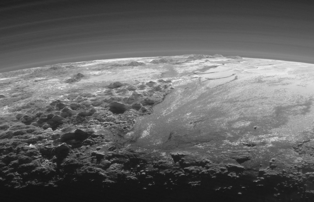 This image of haze layers above Pluto's limb was taken by the Ralph/Multispectral Visible Imaging Camera (MVIC) on NASA's New Horizons spacecraft. About 20 haze layers are seen; the layers have been found to typically extend horizontally over hundreds of kilometers, but are not strictly parallel to the surface. For example, scientists note a haze layer about 3 miles (5 kilometers) above the surface (lower left area of the image), which descends to the surface at the right. – Image Credit: NASA/JHUAPL/SwRI.