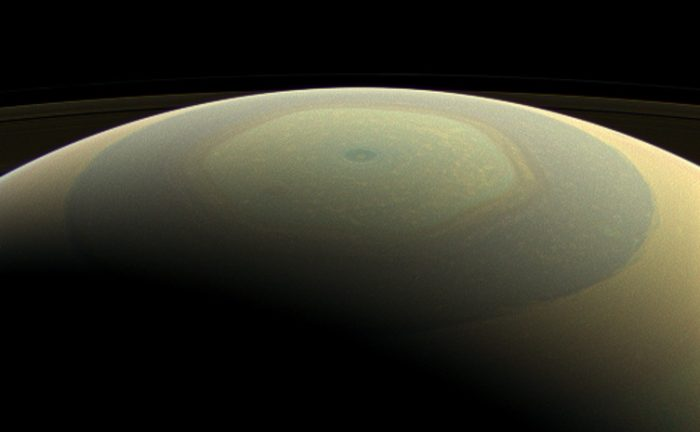 Saturn makes a beautifully striped ornament in this natural-color image, showing its north polar hexagon and central vortex - Image Credit: NASA/JPL-Caltech/Space Science Institute