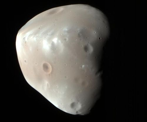 Image of Deimos captured by HiRISE, showing the craters of Voltaire and Swift in the upper left corner. – Image Credit: NASA/JPL/University of Arizona