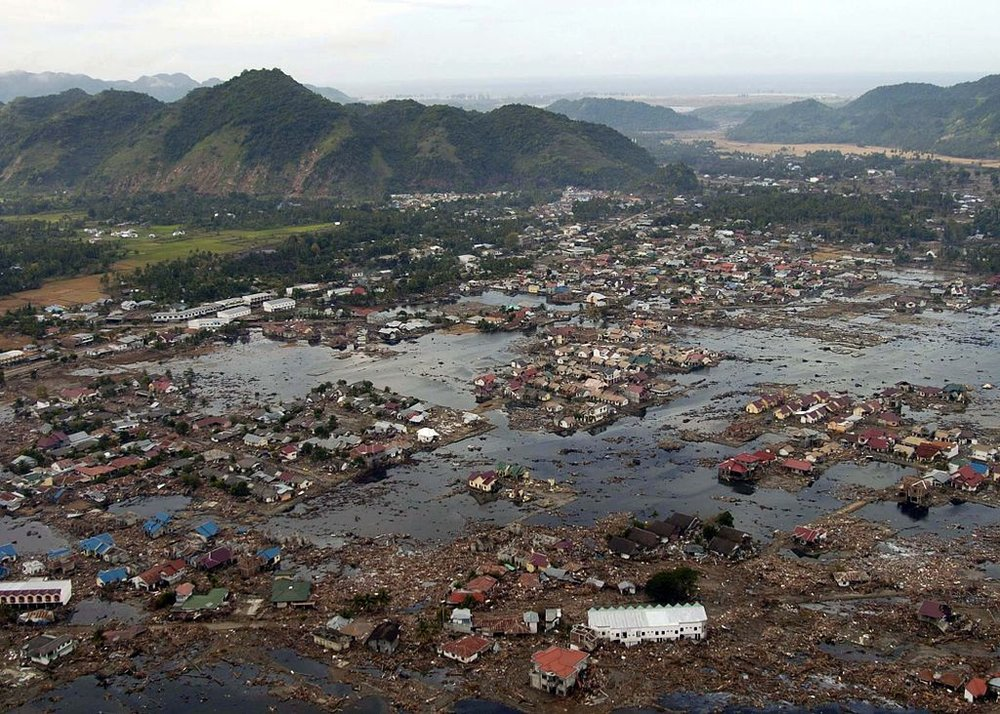 A village near the coast of Sumatra that was devastated by the 2004 Tsunami. - Image Credit: Wikipedia Commons/US Navy