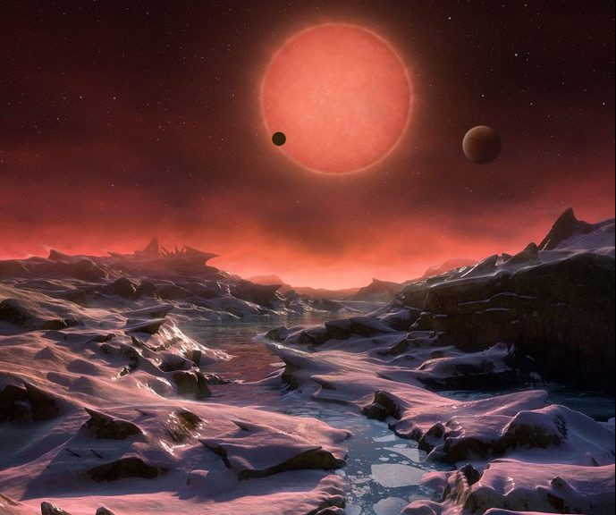 Artist's impression of the view from the most distant exoplanet discovered around the red dwarf star TRAPPIST-1. – Image Credit: ESO/M. Kornmesser.