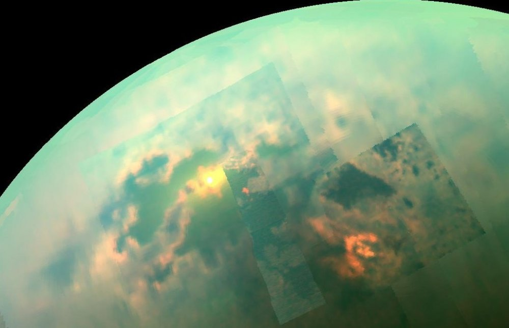 In this near-infrared mosaic, the sun shines off of the seas on Saturn's moon, Titan. - Image Credit: NASA/JPL-Caltech/University of Arizona/University of Idaho