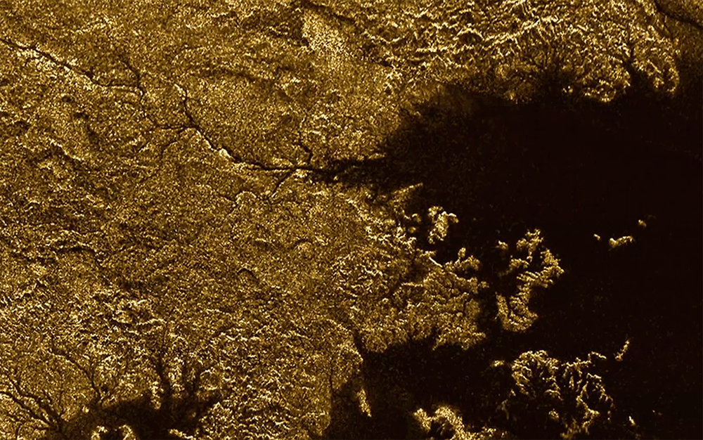 Saturn's largest moon, Titan, has features that resemble Earth's geology, with deep, steep-sided canyons. - Image Credit: NASA/JPL/Cassini