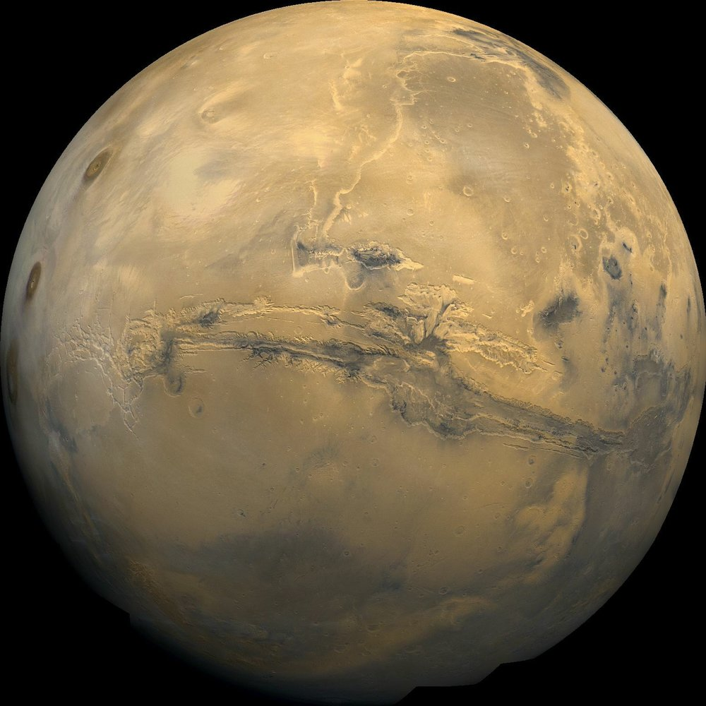 Mosaic of the Valles Marineris hemisphere of Mars, similar to what one would see from orbital distance of 2500 km. – Image Credit: NASA/JPL-Caltech