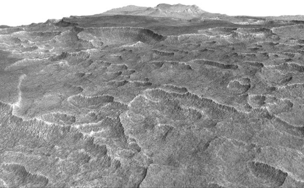 This vertically exaggerated view shows scalloped depressions in a part of Mars where such textures prompted researchers to check for buried ice, using ground-penetrating radar aboard NASA's Mars Reconnaissance Orbiter. They found about as much frozen water as the volume of Lake Superior. - Image   Credits: NASA/JPL-Caltech/Univ. of Arizona