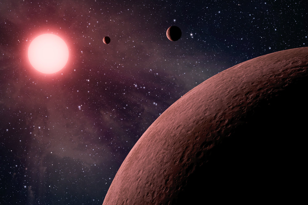 Artist's impression of a system of exoplanets orbiting a low mass, red dwarf star. – Image Credit: NASA/JPL