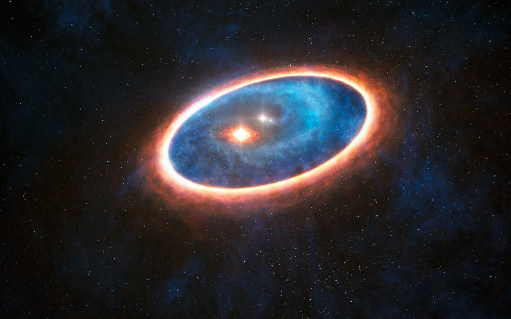 Artist's impression showing the dust and gas around the double star system GG Tauri-A. Researchers using ALMA have detected gas in the region between two discs in this binary system. This may allow planets to form in the gravitationally perturbed environment of the binary. Half of Sun-like stars are bornin binary systems, meaning that these findings will have major consequences for the hunt for exoplanets. – Image  Cedit: ESO/     L. Calçada