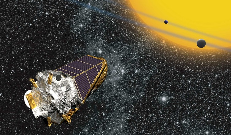 Artist's conception of the Kepler space telescope observing planets transiting a distant star. - Image Credit: NASA Ames/W Stenzel