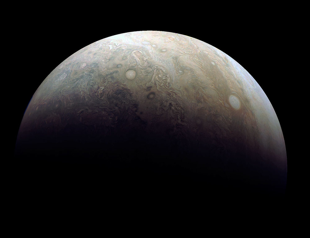 Astro-imager Damian Peach reprocessed one of the latest images taken by Juno's JunoCam during its 3rd close flyby of the planet on Dec. 11. The photo highlights one of the large 'pearls' (right) that forms a string ofstorms in Jupiter's atmosphere. A smaller isolated storm is seen at left. - Image Credit: NASA/JPL-Caltech/SwRI/MSSS