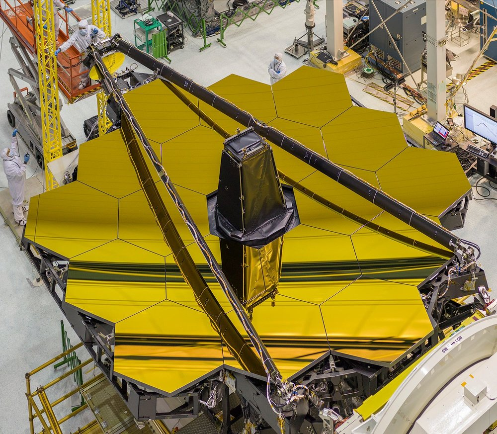 The primary mirror of the James Webb Space Telescope, in all its gleaming glory! - Image Credit: NASA/Chris Gunn