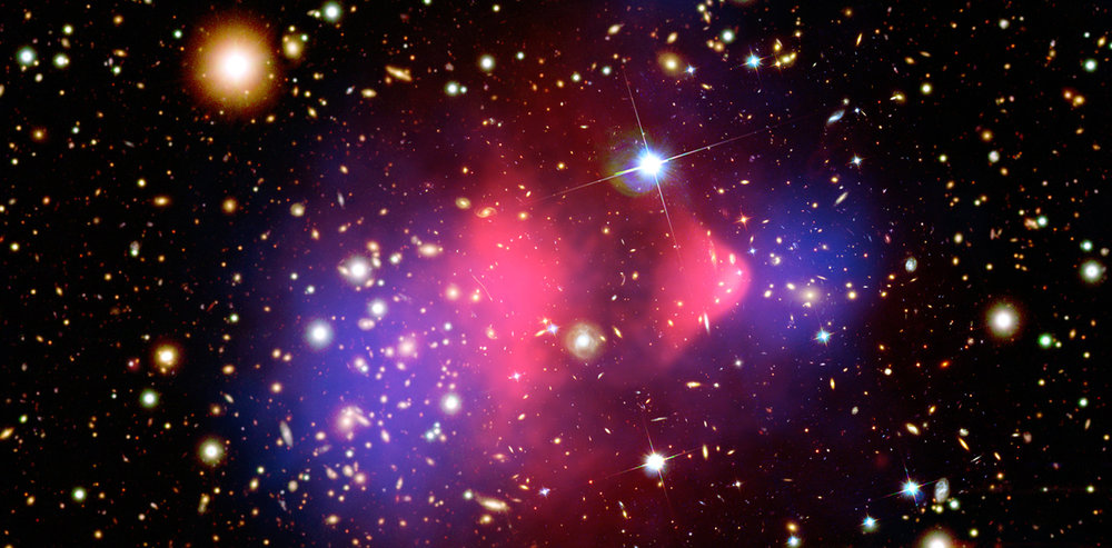 Composite image showing the galaxy cluster 1E 0657-56. - Image Credit: Chandra X-Ray Observatory/NASA