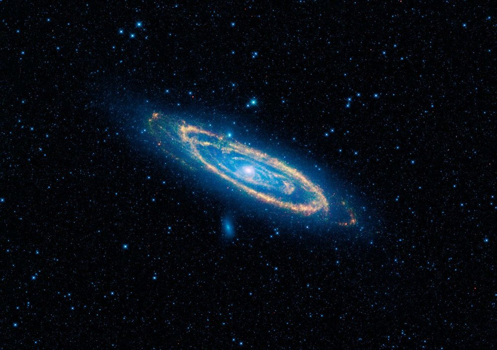 Composite Infrared/visble light image of the Andromeda Galaxy, taken by NASA's Wide-field Infrared Survey Explorer (WISE). - Image Credit: NASA/JPL-Caltech/WISE Team